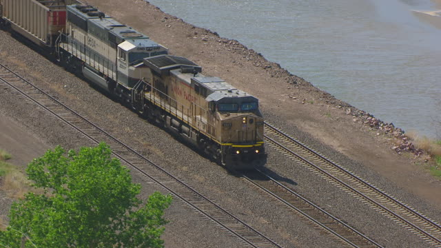 CU AERIAL TS Shot of Union Pacific train en route near Chimney Rock / Nebraska, United States