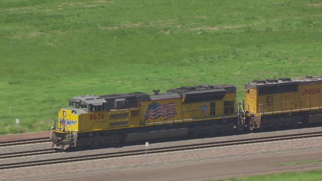 MS AERIAL TS Shot of Union Pacific train on tracks / Nebraska, United States