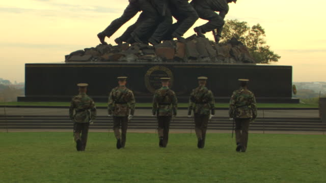 MS ZO Shot of US soldiers in uniform march in front of Iwo Jima and Marine Corps War Memorial / Washington, District of Columbia, United States