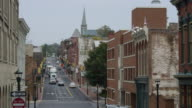 MS Shot of vehicles moving on small town street / Staunton, Virginia, United States