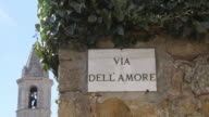 MS Shot of Via dell Amore with Street sign / Pienza, Tuscany, Italy