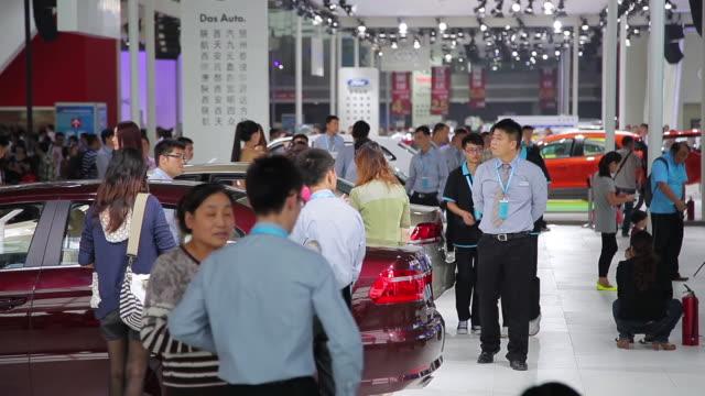 MS Shot of Visitors and salesman at auto show / Xi'an, shaanxi, China