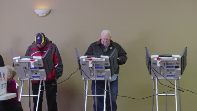 MS Shot of Voters cast ballots at copmuter terminals during voting at union hall / Toledo, Ohio, United States