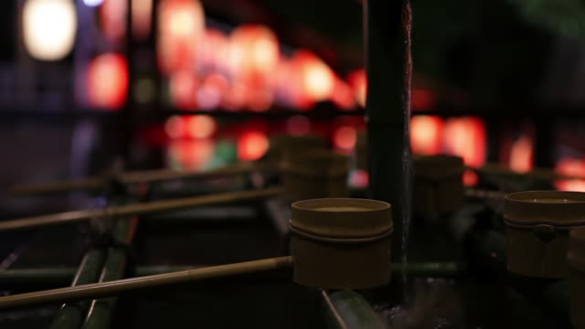 CU Shot of Water filled basins, called chozubachi, with dippers at Hiejinja Shrine / Tokyo, Japan