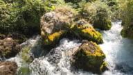 CU Shot of water flowing in River Sorgue / Fontaine de Vaucluse, Vaucluse, France