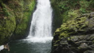 MS SLO MO Shot of waterfall pouring into hidden river canyon with lots of green moss / Hood River, Oregon, United States