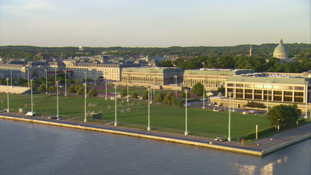 MS AERIAL Shot of waterfront side of US Naval Academy campus / Annapolis, Maryland, United States