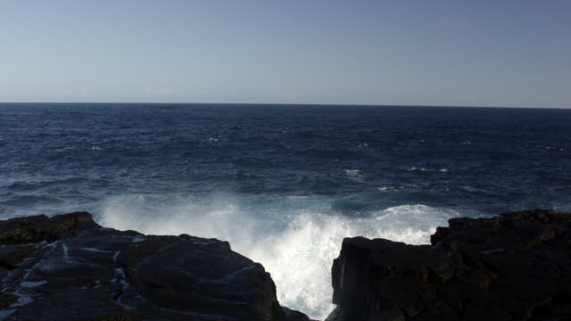 MS SLO MO Shot of waves crashing into rocks with big splash / Waipio, Hawaii, United States