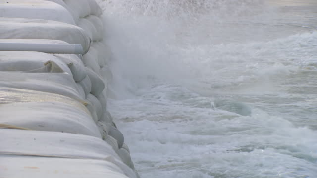 MS Shot of Waves splashing on sandbag wall / Kingscliff, New South Wales, Australia