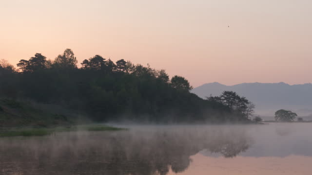 MS T/L Shot of wet fog moving over Uponeup pond / Changnyeonggun, Gyeongsangnam do, South Korea