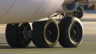 CU TS Shot of Wheel of plane taxiing / Mascot, New South Wales, Australia