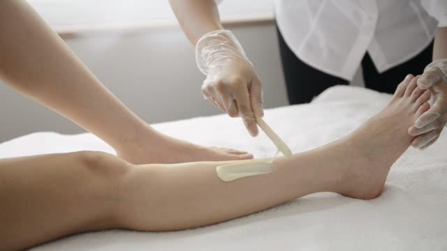 MS Shot of Woman having Brazilian wax hair removal / Kyoto, Japan