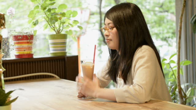 MS Shot of woman is relaxing in café / Kyoto, Japan