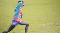 MS Shot of woman makes warm up in jogging wear / Uji, Kyoto, Japan