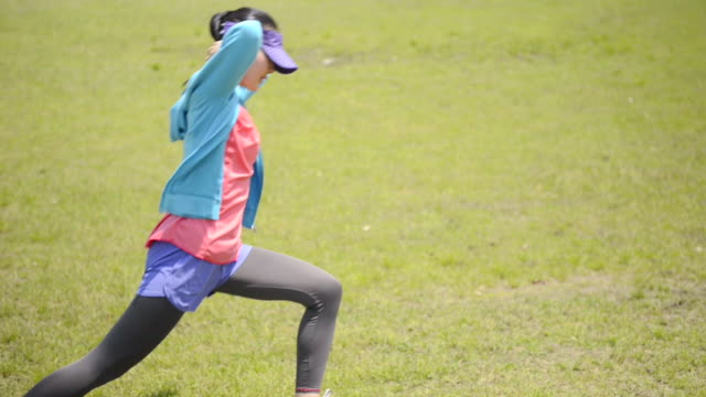 MS Shot of woman makes warm up in jogging wear / Uji, Kyoto, Japan