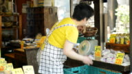 MS PAN Shot of Women greengrocer has weighed in shiitake storefront / Toyooka, Hyogo, Japan