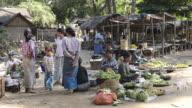 WS Shot of Women selling vegetables on myinkaba market / Bagan, Mandalay Division, Myanmar