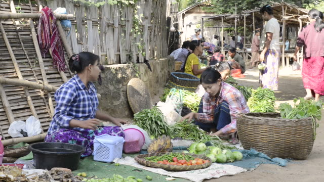 MS Shot of Women selling vegetables on myinkaba market / Bagan, Mandalay Division, Myanmar
