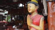 CU Shot of Wood carved figure makes Wai, typical Thai welcome / Island Ko Lanta, Krabi Province, Thailand