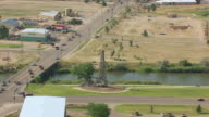 MS AERIAL TS ZO Shot of Wooden derrick to town / Casper, Wyoming, United States