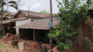 MS POV Shot of wooden houses in village / Serra Pelada, Para, Brazil