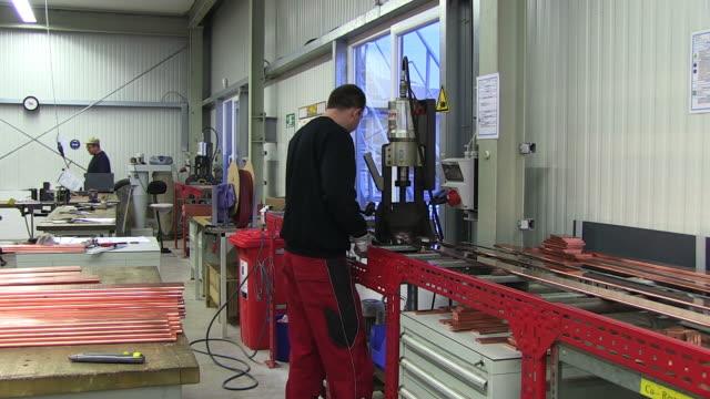MS Shot of Worker working in switchgear assembly shop at switchgear plant / Konz, Rhineland Palatinate, Germany