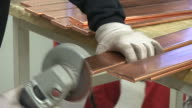 CU Shot of Worker working in switchgear assembly shop at switchgear plant / Konz, Rhineland Palatinate, Germany