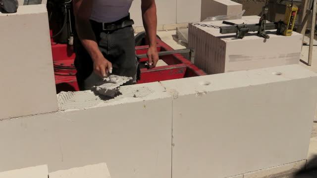 MS Shot of workmen working at house construction / Hermeskeil, Rhineland-Palatinate, Germany