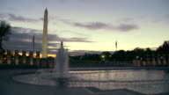 MS PAN Shot of World War II Memorial with water fountain and Washington Monument / Washington, District of Columbia, United States