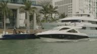 MS TS Shot of yachts in canal between buildings / Miami, Florida, United States