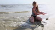 MS Shot of young girl building sand castle at beach / St. Simons Island, Georgia, United States