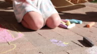 MS Shot of young girl drawing on ground with chalk / Lamy, New Mexico, United States