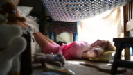 MS Shot of young girl lying on her bedroom floor / Santa Fe, New Mexico, United States