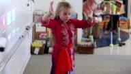 MS Shot of young girl performing dance in school / Ubud, Bali, Indonesia