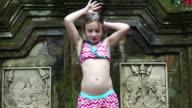 CU Shot of young girl taking outdoor shower / Ubud, Bali, Indonesia