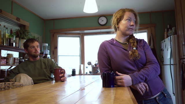 MS SLO MO LA Shot of Young organic farm couple having morning coffee and discussion / Chatham, Michigan, United States