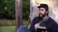 MS PAN Shot of Young Union soldier writes letter / Middleburg, Virginia, United States