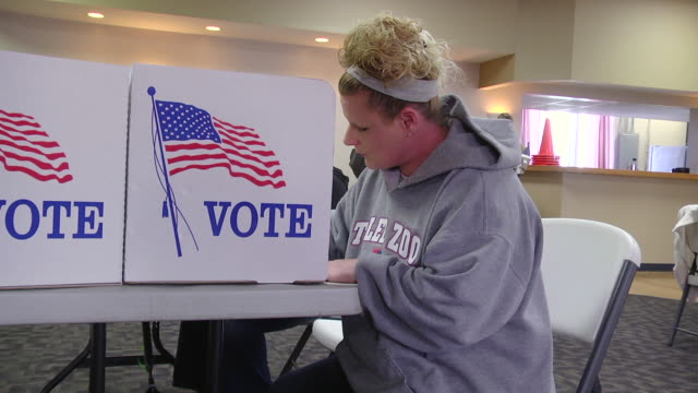 MS Shot of young white middle class woman votes provisional ballot in presidnetial election at UAW hall / Toledo, Ohio, United States