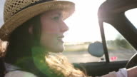 CU PAN Shot of young woman driving convertible / Santa Fe, New Mexico, United States