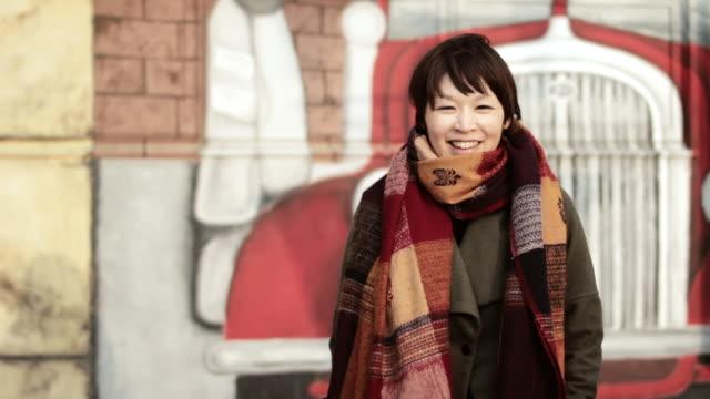 MS Shot of young woman smiling / Chatan, Okinawa, Japan