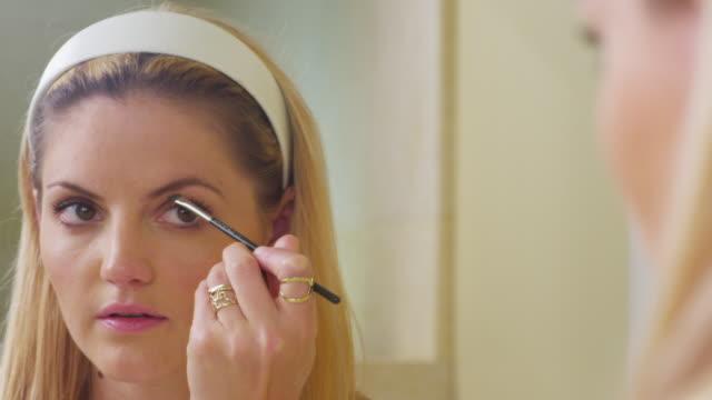 CU PAN Shot of Young woman using eye brow brush / Santa Cruz, California, United States