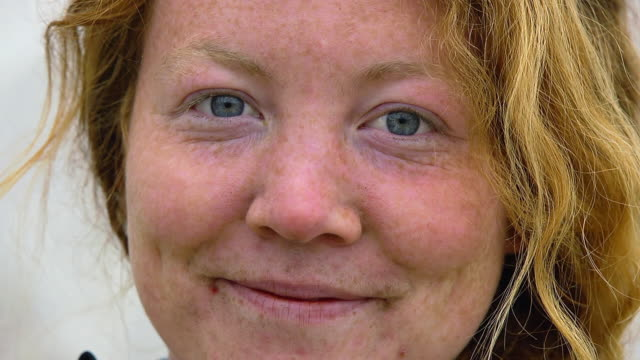 CU SLO MO Shot of young woman with blue eyes and freckles / Chatham, Michigan, United States