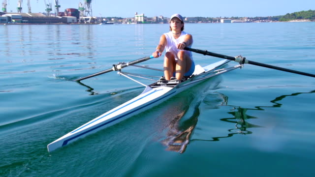HD: Shot of Young Women Rowing