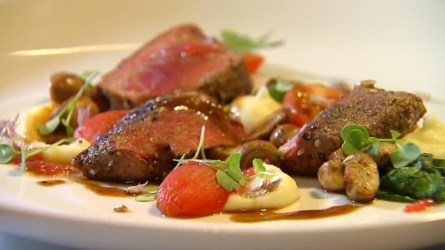 CU PAN Shot over gourmet meal consisting mainly of fillet steak