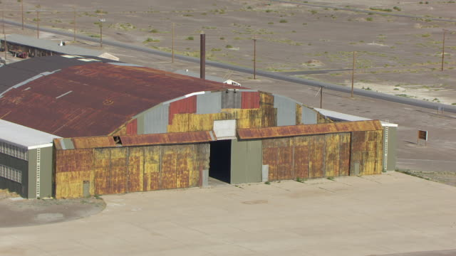 CU AERIAL DS Shot over hangar entrance at Wendover airfield / Wendover, Utah, United States