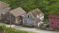 MS AERIAL Shot over house with native mural on exterior walls / Angoon, Alaska, United States