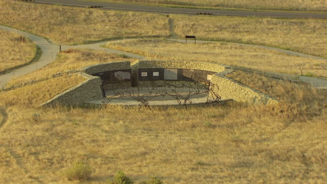MS AERIAL DS Shot over Indian Memorial at Little Bighorn by Last Stand Hill / Crow Agency, Montana, United States
