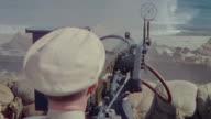 MS Shot over navy officer firing in shore