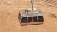 MS TS HA Shot over passengers riding cable car up Masada in Negev desert / Israel