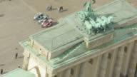 MS AERIAL PAN Shot over people walking near Brandenburg Gate / Berlin, Germany